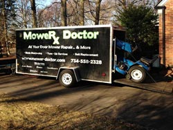 Riding Mower in Mobile Lawn Mower Repair Trailer - 3